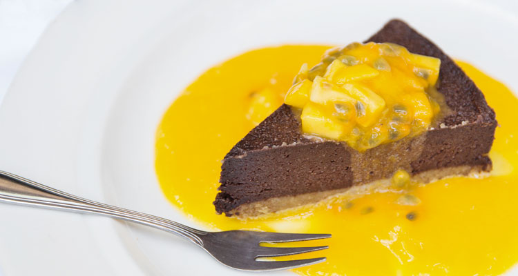 Delicious raw chocolate cake with mango and passionfruit ends another delicious meal at your yoga retreat in Ubud.