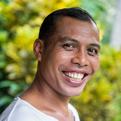 Wayan Partawan is passionate about yoga and Bali and loves to share his passion with yoga retreat participants in Bali.