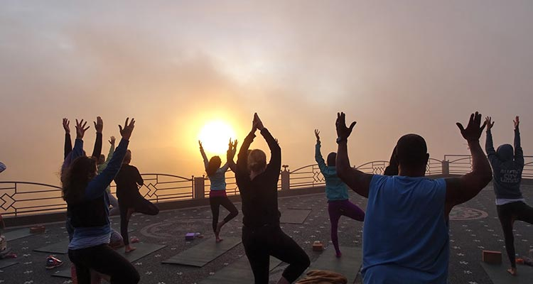 yoga with the view of batur volcano